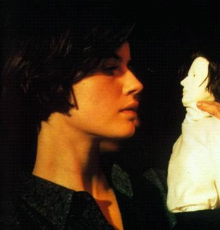 Irene Jacob in Double Life of Veronique, gazing at the puppet - of herself - that Alexandre Fabbri has created. (http://images.google.com/imgres?imgurl=http://www.moviemail-online.co.uk/images/)</